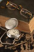 Vintage pocket watch old book brass key — Stock Photo