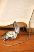 Vintage pocket watch and open old book  — Stock Photo