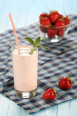 Strawberry with yogurt in a glass on a wooden background  — Stock Photo