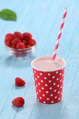 Raspberry yogurt cup with a straw — Stock Photo