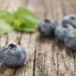 Fresh blueberries close up on a background of wooden planks — Stock Photo #51552269