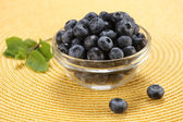 Fresh berries in a glass bowl — Stock Photo
