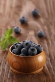 Blueberries in a wooden bowl  — 图库照片