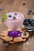 Yogurt with blueberries in a glass bowl and blueberries in a gla — Foto Stock