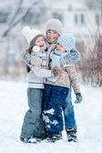 Children playing in the snow on a winter day — Stock Photo