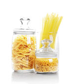 Macaroni in glass container — Stock Photo