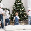 Children decorate the Christmas tree — Stock Photo #43968409