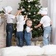 Children decorate the Christmas tree — Stock Photo #43969697