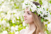 Girl in blossoming apple wreath — Stock Photo