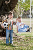 Little boys shake on a swing — Stock Photo