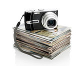 Digital camera and the heap of photos — Foto de Stock