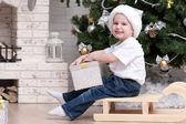 Boy near Christmas tree — Stock Photo
