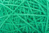 Green connected woolen cloth — Stock Photo