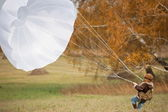 Girl with parachute — 图库照片