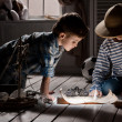 Boys travelers studying maps and books — Stock Photo #43971979