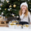 Girl with gifts under the Christmas tree — Stock Photo #43972049