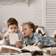 Boys travelers studying maps and books — Stock Photo