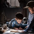 Boys travelers studying maps and  books — Stock Photo #43977537