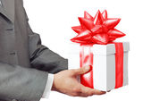 The businessman offering to you a gift — Stock Photo