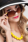 Girl  in glasses and hat — Stock Photo