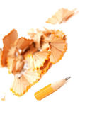 Sharpened pencil with chips — Stock Photo