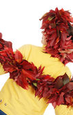 Woman in a wreath from autumn leaves — Stock Photo
