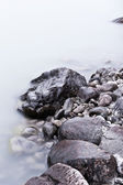 Coastal stones in water — Stock Photo
