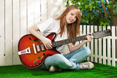 Teenage girl with a guitar — Stock Photo