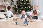 Children with  Christmas gifts — Stock Photo