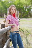 Girl - cowboy near the old fence — Stock Photo