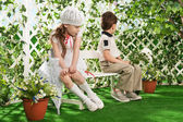 Hurt each other a boy and a girl in a garden — Stock Photo