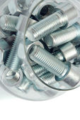 Bolts in bowl — Stock Photo