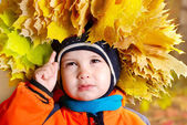 Child with a wreath from leaves — Stock Photo