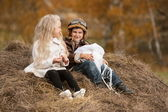 Boy and girl on haystack — Foto Stock