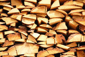 Firewood in woodpile — Stock Photo