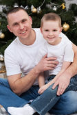 Father and son near Christmas tree — Stock Photo