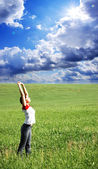 Girl enjoys a solar heat on a meadow — Foto Stock