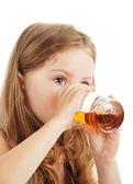 Girl drink juice — Stock Photo