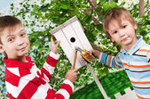 Boys make a birdhouse for birds — ストック写真