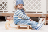 Little girl on a sled — Stock Photo