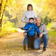 Family on a walk on a sunny autumn day — Stock Photo #43981217