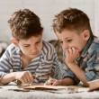 Boys travelers studying maps and books — Stock Photo #43981825