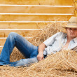 Young man lying on hay — Stock Photo #43982079