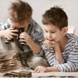 Boys travelers studying maps and books — Stock Photo #43985769