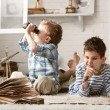 Boys travelers studying maps and books — Stock Photo #43988269