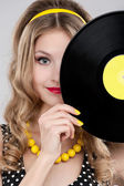 Young girl with vinyl record — Stock Photo
