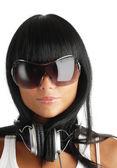 Girl in sunglasses and headphones — Stock Photo