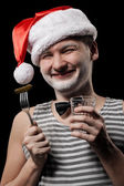 Santa Claus with a glass of vodka and pickle — Stockfoto