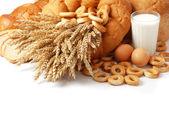 Wheat, bread, milk and eggs — Stock Photo