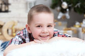 Little boy lies on a pillow — Stock Photo